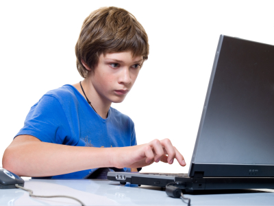 Boy writing on laptop